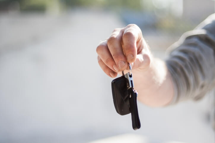 male hand with car key