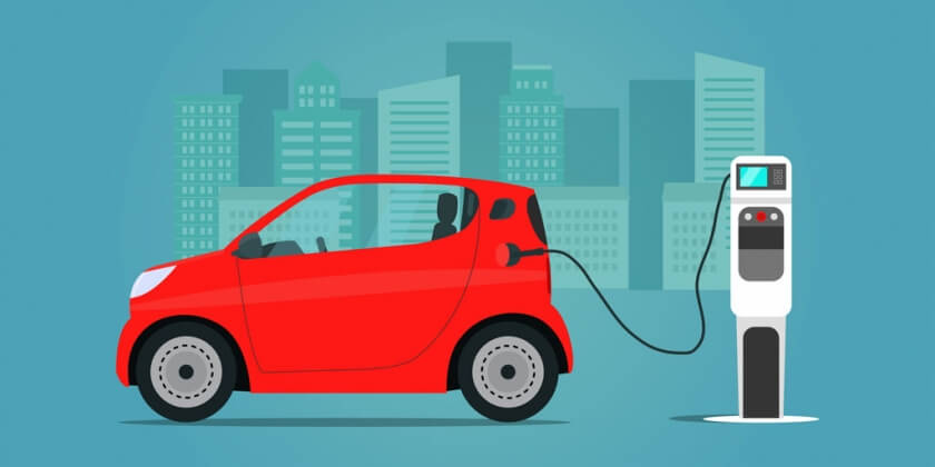 red-compact-electric-car-charging-side.jpg