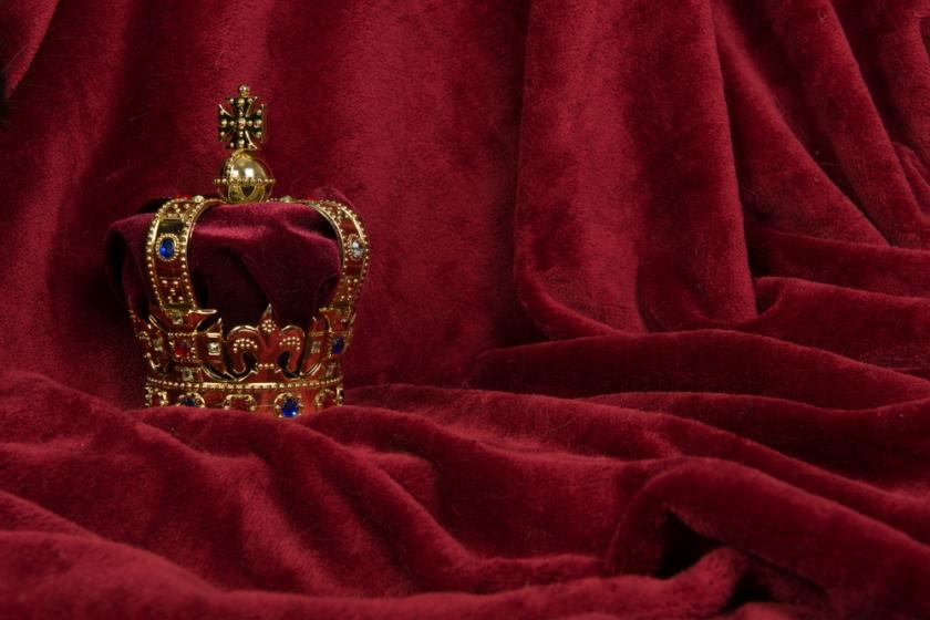 Crown on red fabric
