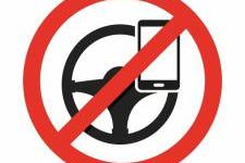 UK to Ban any use of Hand Held Mobile Phones While Driving